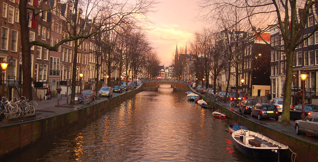 Enjoy an evening walk along the iconic canals...