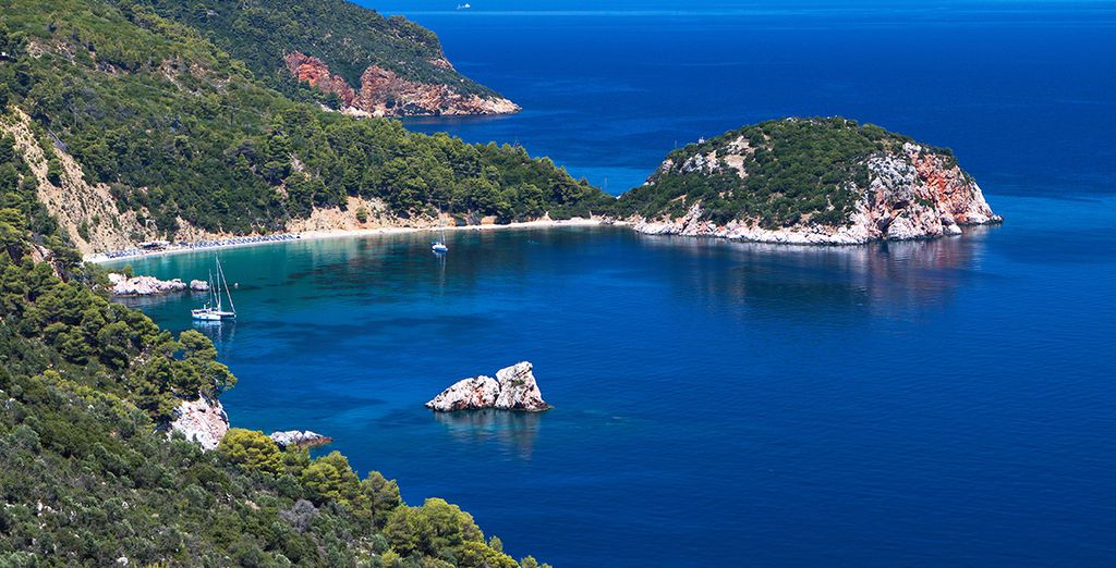 Situated on the hilltop above Stafilos Bay