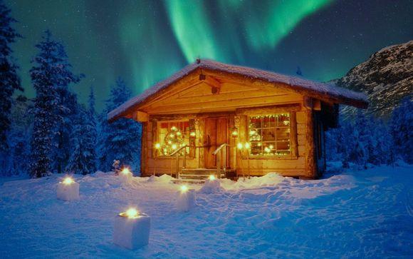 Magica vacanza di Babbo Natale in famiglia con husky e safari in motoslitta